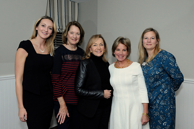 Four women who are part of the Women's Leadership Network standing together