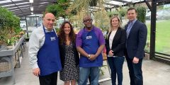 First Bank of Greenwich President and CEO Frank Gaudio; Abilis President and CEO Amy Montimurro; Abilis client Theo Brown; FBOG Vice President and Retail Banking Manager Emily Newcamp; and FBOG Chief Lending Officer Evan Corsello, at Abilis' greenhouse. (Richard Kaufman photo)