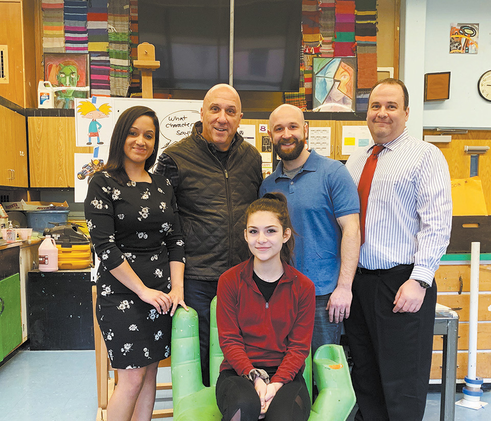 First Bank of Greenwich Assistant Branch Manager Amy Huertas, FBOG CEO and President Frank Gaudio, EMS art teacher Benjamin Quesnel, FBOG Business Development Specialist Anthony Cortese. Seated is Victoria Sirito, co-founder and co-president of the EMS Curator's Club.